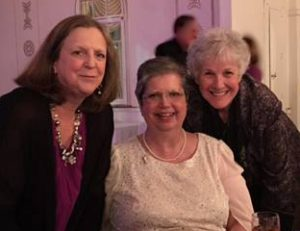 portrait of three women at a formal event