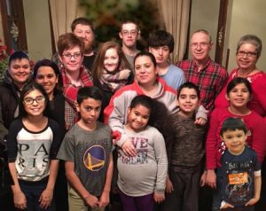 a portrait of a large family with many children, parents and grandparents