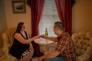 Couple toasting with sparkling grape juice