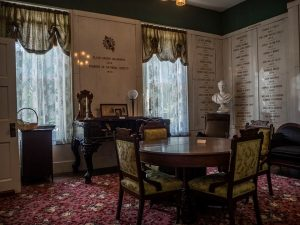 Small dining room in historic Governor Duncan Home furnished with antiques including table, chairs and buffet