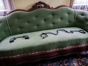 Slave chains laying on a formal upholstered sofa in Woodlawn Farm, and Underground Railroad Home