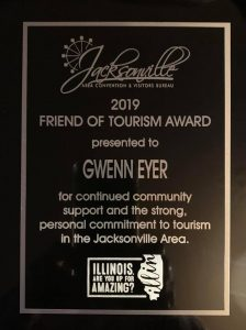 Plaque reads 2019 Friend of Tourism Award presented to Gwenn Eyer for continued community support and a strong, personal commitment to tourism and the Jacksonville Area