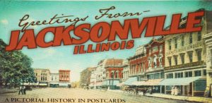 Vintage Jacksonville Illinois postcard with downtown storefront scene