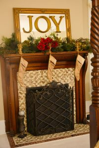 Fireplace with Christmas greens and stockings