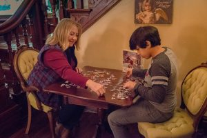 woman and boy doing jigsaw puzzle