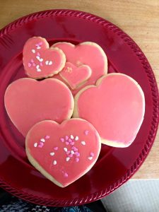 Pink Heart shaped Sugar Cookies on red plate