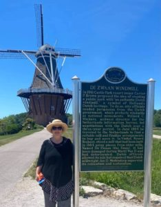 Woman standing in front of windmill