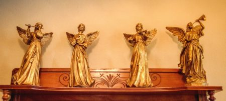 Wooden angels on a mantel