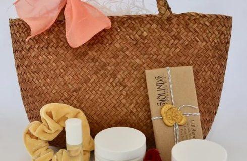 Rattan handbag with orange bow, lotion, bath salts and hair scrunchies