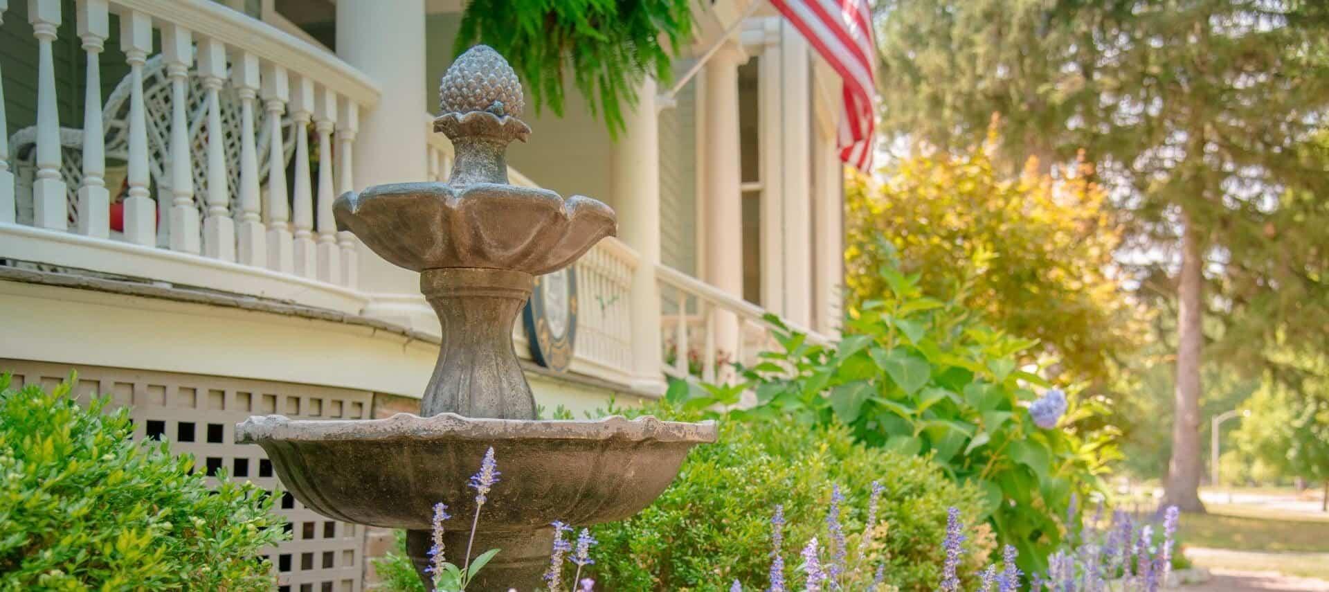 fountain in flowery landscape