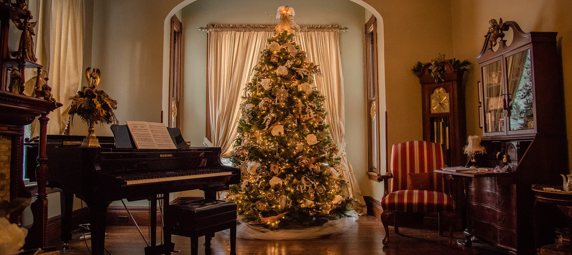 baby grand piano and gold trimmed Christmas tree