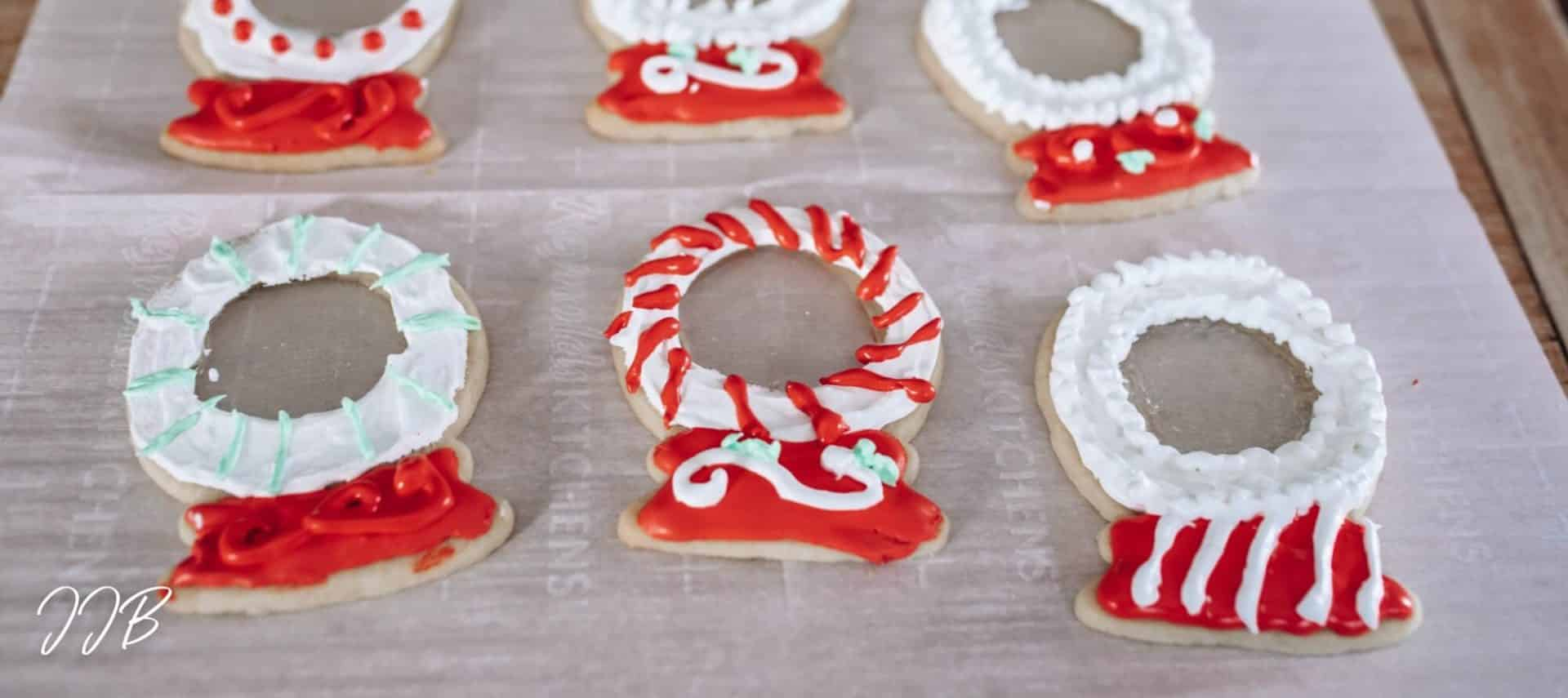 red and green snow globe shaped sugar cookies