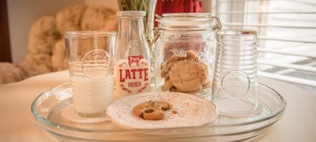 Latte milk bottle and mason style cookie jar with cookies and a cookie on a plate