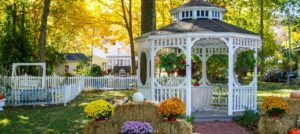Fall view of white gazebo and fenced gardens (1)