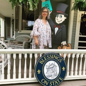 woman standing next to a flat cartoon cutout of Abraham Lincoln