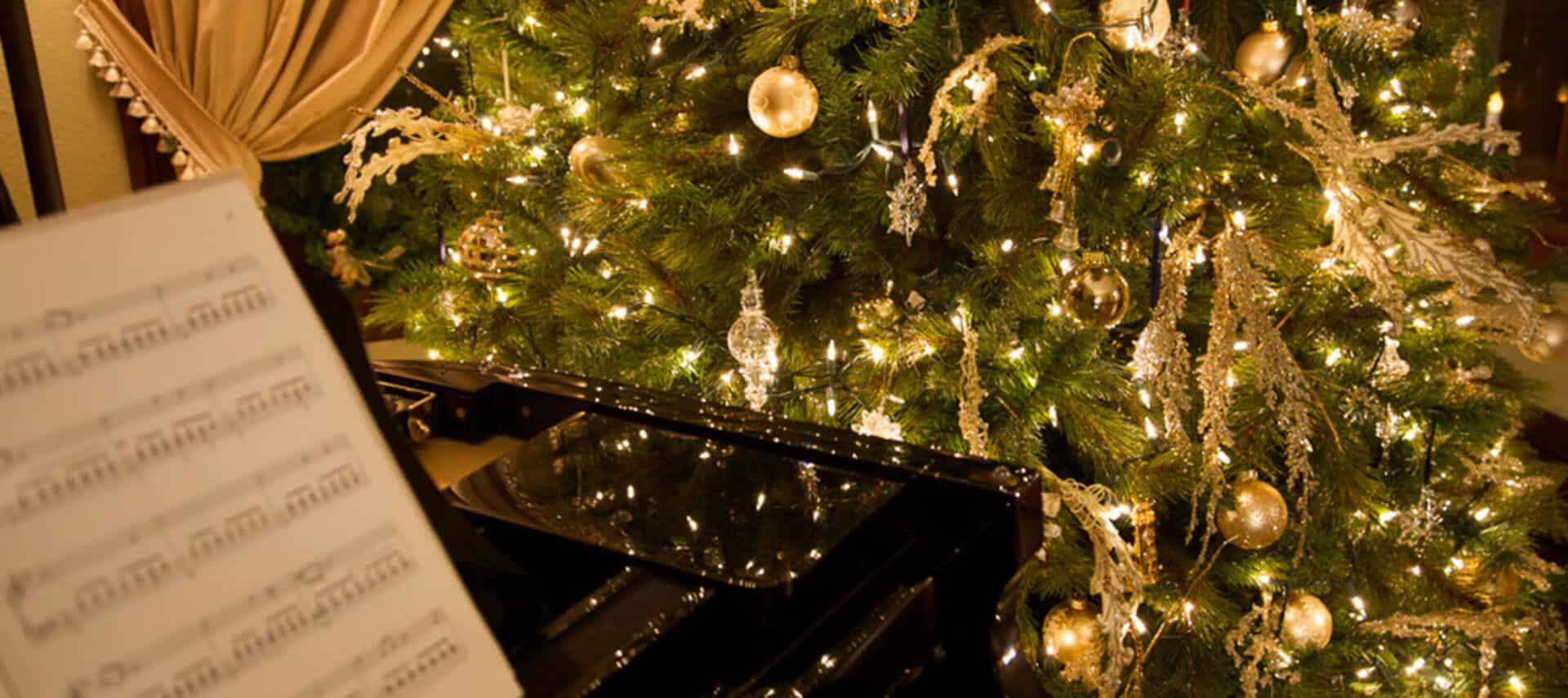 Christmas tree shines in glossy baby grand piano