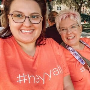 Two smiling women wearing peach color #Hey Y'all T-shirts