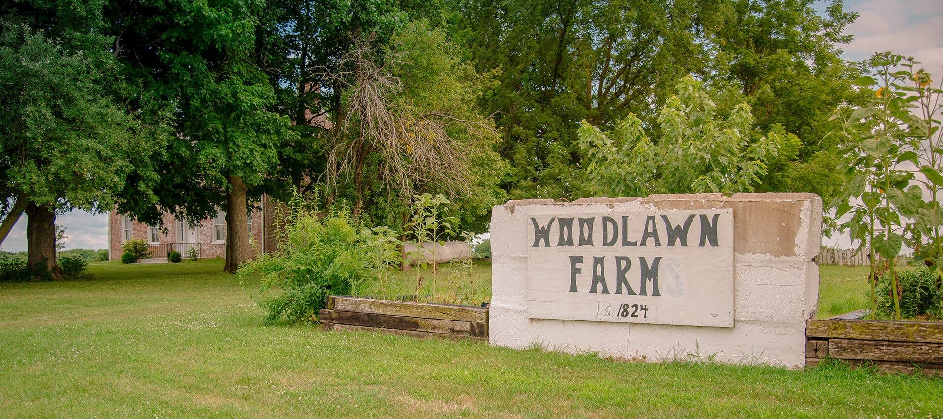 rustic Woodlawn Farm sign