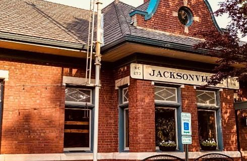 Exterior view of red brick building with blue trim and Jacksonville sign