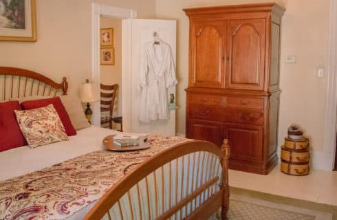 king sized wheat bed with dark wood armoire