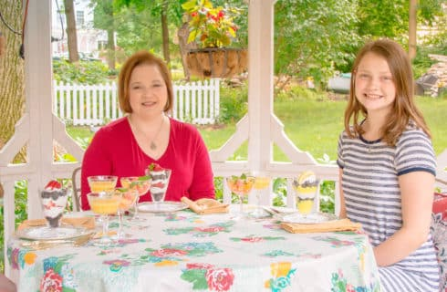 mom and two daughters have breakfast in gazebo
