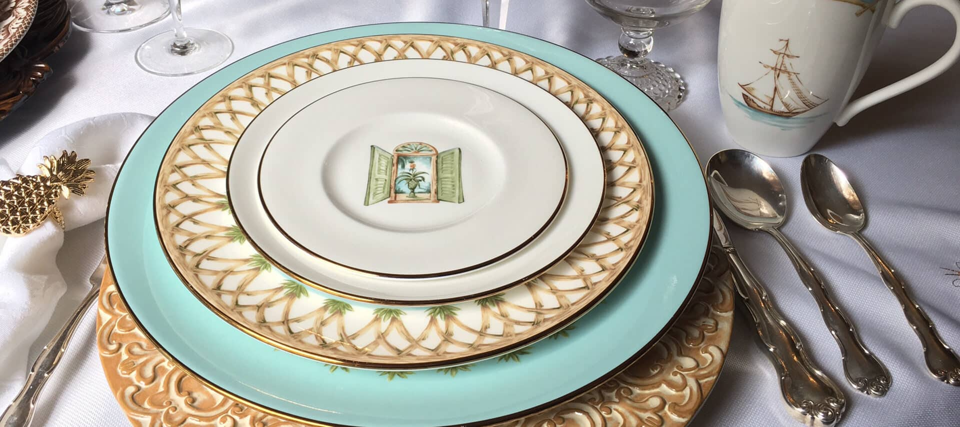 Gold and turquoise plates on gold charger plate