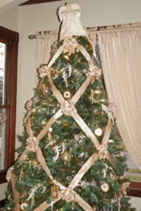 Christmas tree with ribbon diamond design with bows at the intersections