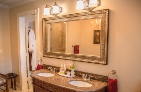 Bathroom with double vanity and large framed mirror