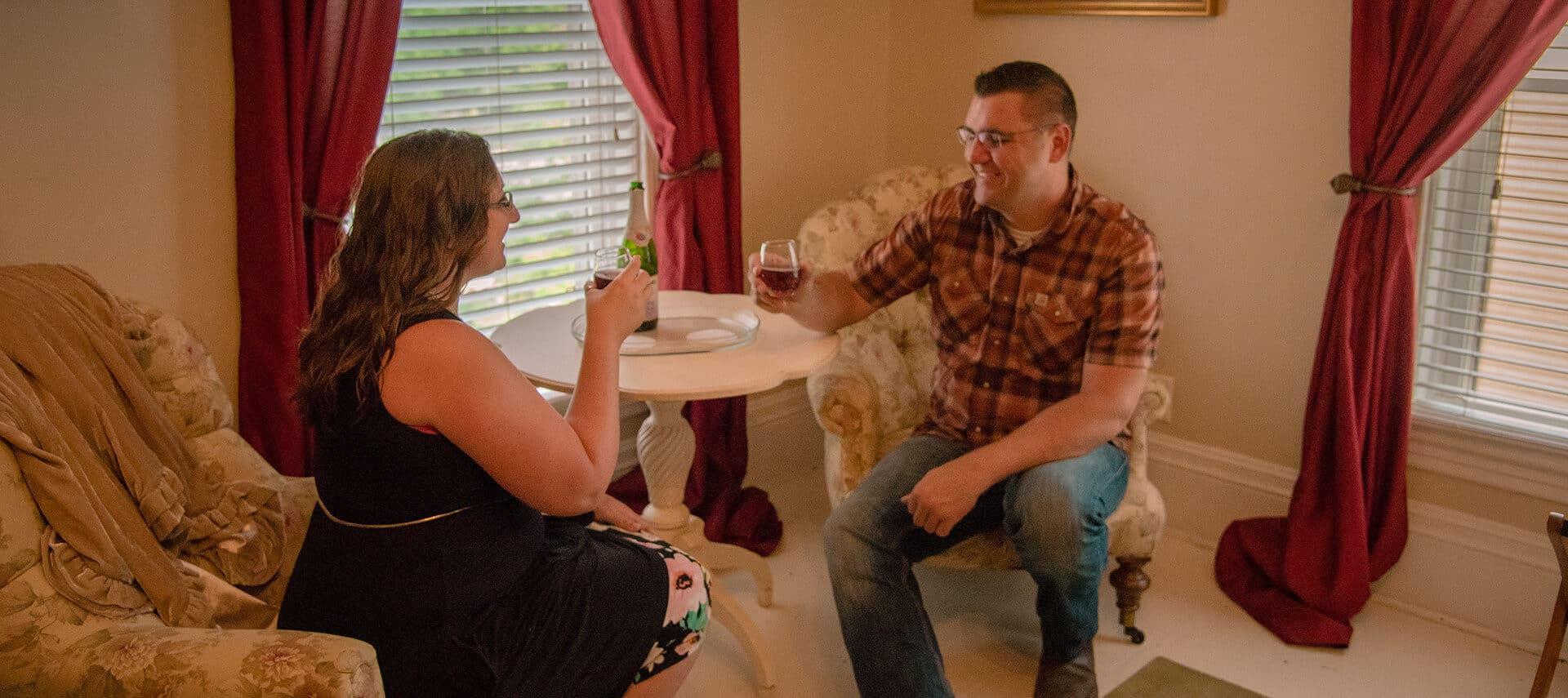 young couple toasting with glasses of wine