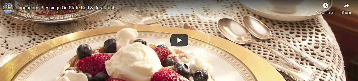 Screenshot of video showing a plate of waffles with berries and whipped cream