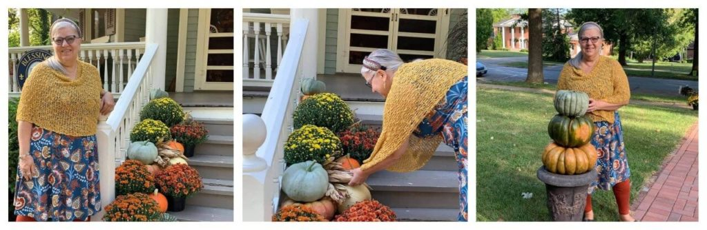 woman in a gold shawl decorating front porch steps
